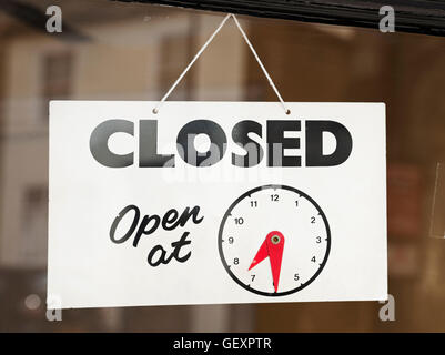 Closed sign on shop door. - Stock Photo