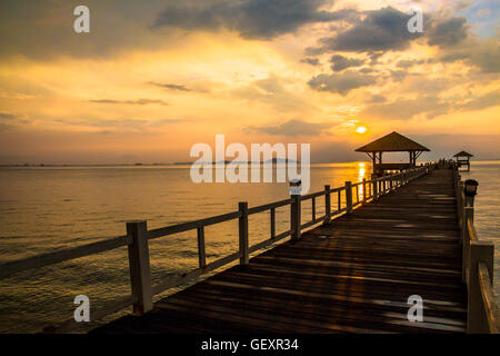 Landscape of Wooded bridge in the port between sunsets at Pattaya beach, Thailand - Stock Photo