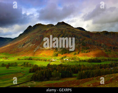 A winter view across Langdale Valley towards the Langdale Pikes. - Stock Photo