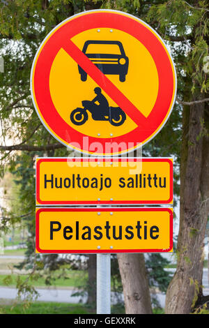 European round red and yellow traffic sign, the passage of vehicles and motorcycles is prohibited - Stock Photo