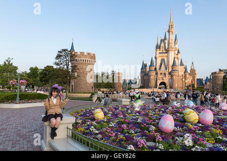 Cinderella's castle with Easter decoration at the Tokyo Disney Resort in Japan - Stock Photo