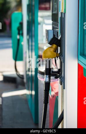 fuel oil gasoline dispenser at petrol filling station - Stock Photo