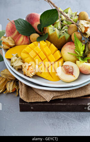 Assorted tropical fruits on a plate - Stock Photo