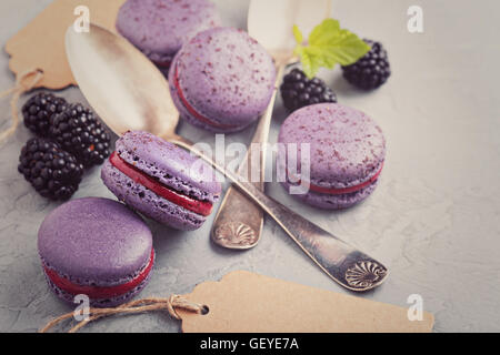French macarons on a gray table - Stock Photo