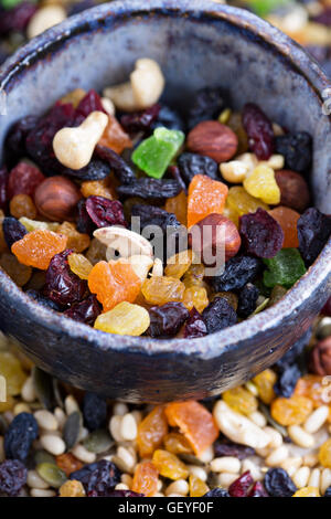 Mixed nuts and fruits in a bowl - Stock Photo