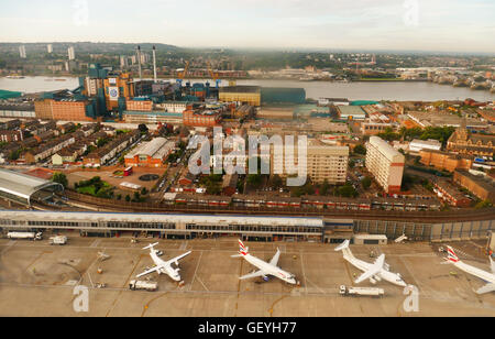 View from an aircraft taking off from London City Airport, the River Thames in the background with Tate & Lyle factory - Stock Photo