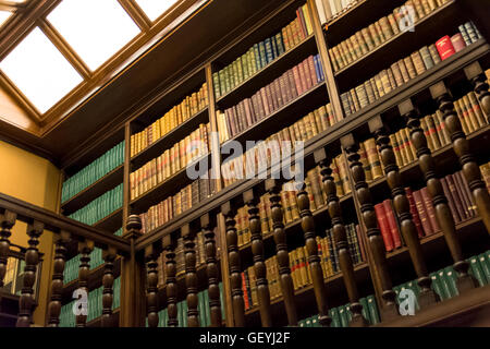 Low angle view of Books arranged in bookshelves - Stock Photo