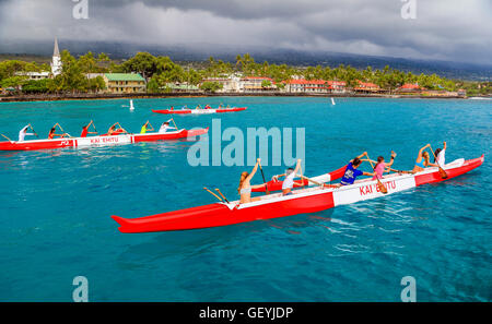 Outrigger canoes in Kailua Bay on the Big Island of Hawaii - Stock Photo