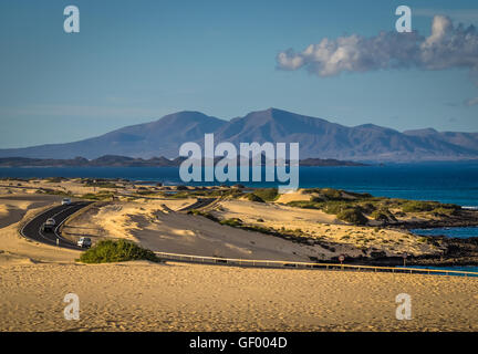 Road through the Corralejo Dunes National Park in Fuerteventura, Canary Islands, Spain - Stock Photo