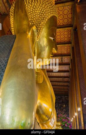 Reclining big Buddha gold statue in Wat Pho, Bangkok, Thailand - Stock Photo