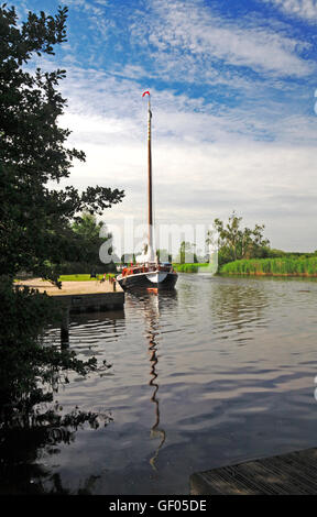 A view of the Norfolk Pleasure Wherry, Hathor, moored on the River Ant by How Hill, Ludham, Norfolk, England, United - Stock Photo