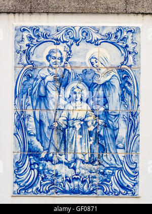 Porcelain plaque depicting the Holy Family on the wall above door in the Ponta Delgada town in Sao Miguel, Azores - Stock Photo