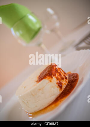 Queijo Fresco - a unique and delicious speciality of the Azores - cheese served with slightly spicy sauce based - Stock Photo