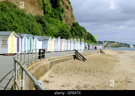 Shanklin, Isle of Wight, UK. June 21, 2016. A row of colorful beach huts on the promenade under the cliffs at small - Stock Photo