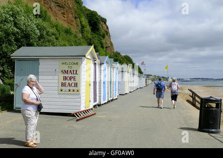 Shanklin, Isle of Wight, UK. June 21, 2016.  A senior lady and a couple on the promenade with beach huts at Small - Stock Photo
