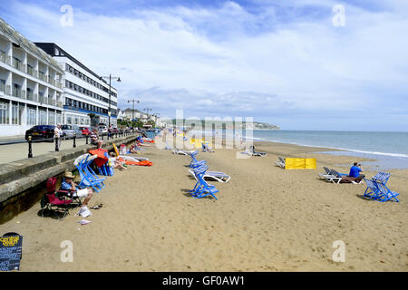 Sandown, Isle of Wight, UK. June 21, 2016.  Holidaymakers enjoy the sand and the seaside on the beach and the seafront. - Stock Photo