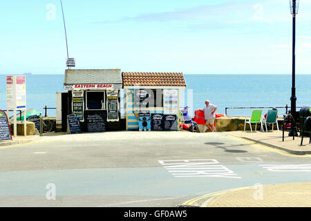 Sandown, Isle of Wight, UK. June 21, 2016. Holidaymakers can get hire for beach huts and deck chairs from separate - Stock Photo
