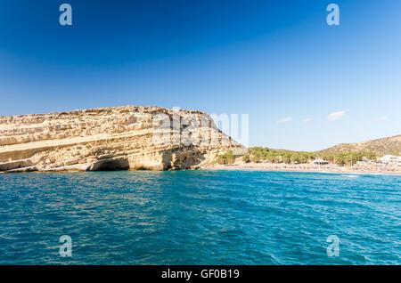 Matala beach on Crete island, Greece. There are many caves near the beach. - Stock Photo
