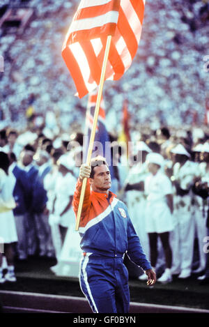 Ed Burke is flag-bearer for US team during opening ceremonies at 1984 Olympic Games in Los Angeles. - Stock Photo
