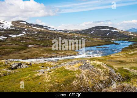 River flowing over waterfalls in Springtime, Hardangervidda National Park, Norway, Scandinavia, European - Stock Photo