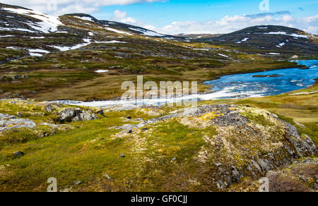 River flowing over waterfalls in Springtime, Hardangervidda National Park, Norway, Hordaland, Scandinavia, European - Stock Photo