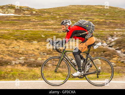 Road cyclist peddling, route 7 Hardangervidda National Park next to Lake Orteren, Norway, Hordaland, Scandinavia, - Stock Photo