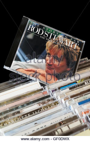The Story So Far, The Very Best Of  Rod Stewart CD pulled out from among rows of other CD's - Stock Photo