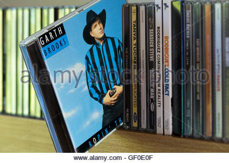The 1991 Garth Brooks album, Ropin' the Wind, CD pulled out from other CD's on a shelf - Stock Photo