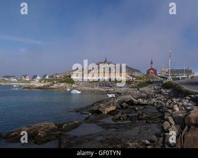 View across Sissiugaq bay to Our Saviours Church and Hans Egede Statue Old colonial district Nuuk Capital city of - Stock Photo