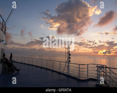 View of sunset from main deck of Minoan Lines Ferry Cruise Ship Olympia during journey from Ancona, Italy to Igoumenitsa, - Stock Photo