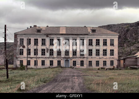 empty abandoned school house in mountain village in Arctic - Stock Photo