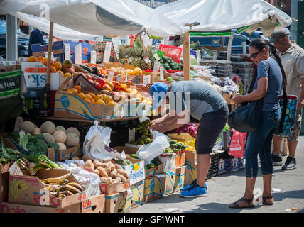 A fruit and vegetable stand in the Chelsea neighborhood of New York on Friday, July 22, 2016.  (© Richard B. Levine) - Stock Photo