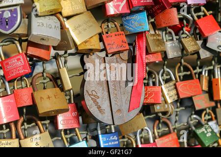 Love locks on Hohenzollern Bridge, Cologne, Germany - Stock Photo