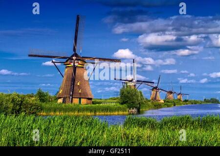 Famous historical windmills in Kinderdijk, Holland, Netherlands - Stock Photo