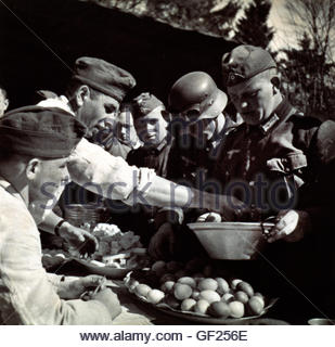 German Soldiers Queue For Rations Receiving Three Hardboiled Eggs In Bowl Western Front 1940 From The Book Der Kampf - Stock Photo