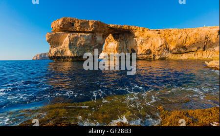 Azure Window, famous stone arch on Gozo island with reflection, Malta - Stock Photo