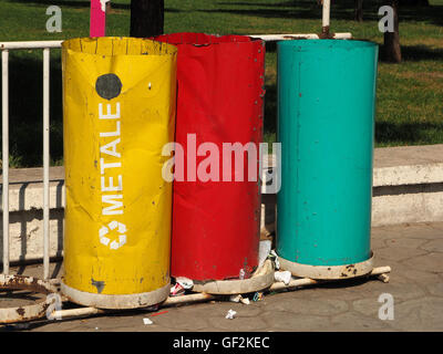 Brightly painted metal refuse recycling bins in Tirana capital of Albania - Stock Photo