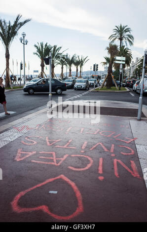 NICE,FRANCE -  JULY 26:  nice habitants and tourist  keep bringing  flowers and dolls to remember the victims of - Stock Photo