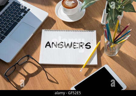 ANSWERS open book on table and coffee Business - Stock Photo