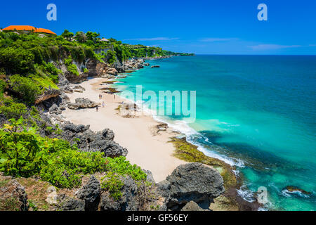 Scenic landscape of high cliff and clean azure water on Tropical beach - Stock Photo
