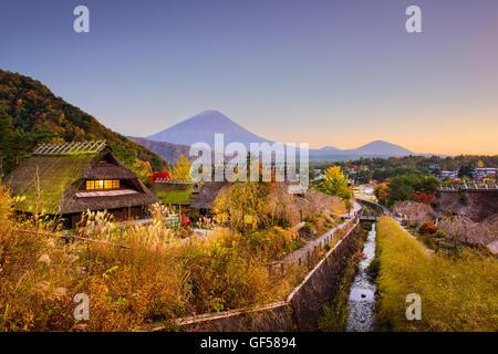 Mt. Fuji, Japan with historic village Iyashi no Sato during autumn. - Stock Photo