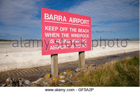 The sign for Barra Airport by Traigh Mhor Beach - the runway for the airport, Isle of Barra, Outer Hebrides. Scotland - Stock Photo