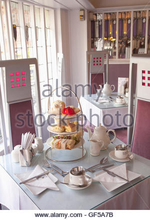 Afternoon tea in the Willow Tearoom designed by celebrated Glasgow architect, Charles Rennie Mackintosh, Glasgow - Stock Photo