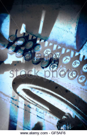 Vintage shop till keys moody image with strong shadows - Stock Photo