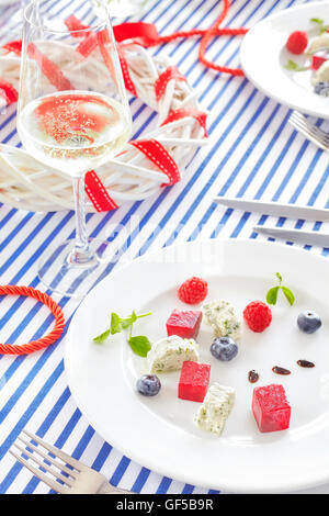 Appetizer made of beet, cottage cheese with fruits on sailing style decorated table. - Stock Photo