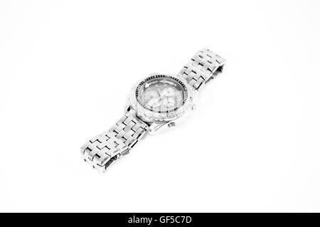A silver and black watch with four buttons and three dials on a white background. - Stock Photo