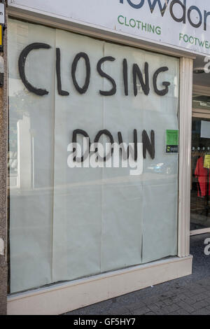 Shop Closing Down sign. Metaphor recession, economic slow-down, falling sales, retail and high street crisis casualties, - Stock Photo