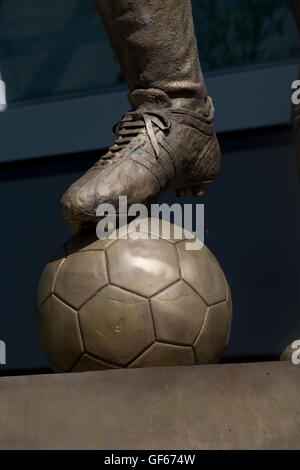 Boot and football of Albert Florian statue outside Groupama Arena - Stock Photo