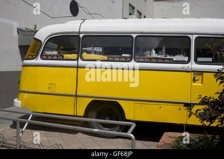 yellow camper van parked in District IX - Stock Photo
