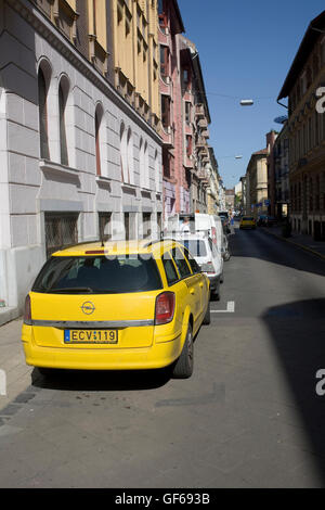 Bokreta utca with yellow taxi parked in District IX - Stock Photo